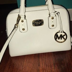White Michael kors bag some blue jean discoloratio